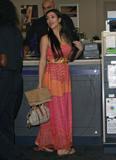 Kim Kardashian shows cleavage at the local Kinko's in West Hollywood
